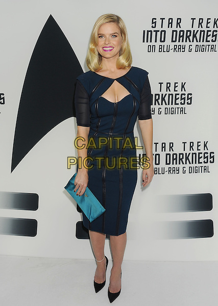 Alice Eve<br /> &quot;Star Trek Into Darkness&quot; DVD/Blu-Ray Release held at the California Science Center, Los Angeles, California, USA.<br /> September 10th, 2013<br /> full length blue dress black turquoise clutch bag cut out away stripe strips leather <br /> CAP/ROT/TM<br /> &copy;Tony Michaels/Roth Stock/Capital Pictures