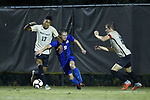 Daniele Proch (9) of the Duke Blue Devils battles for the ball with with Logan Gdula (17) and Sam Raben (26) of the Wake Forest Demon Deacons during first half action at W. Dennie Spry Soccer Stadium on September 29, 2018 in Winston-Salem, North Carolina.  The Demon Deacons defeated the Blue Devils 4-2.  (Brian Westerholt/Sports On Film)
