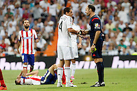 Chicharito of Real Madrid and Gabi of Atletico de Madrid during La Liga match between Real Madrid and Atletico de Madrid at Santiago Bernabeu stadium in Madrid, Spain. September 13, 2014. (ALTERPHOTOS/Caro Marin)