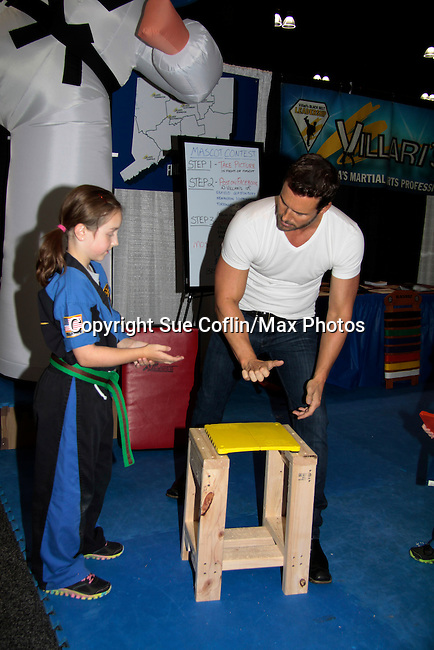 """Days of Our Lives Eric Martsolf """"Brady Black"""" appears at the 12th Annual Comcast Women's Expo on September 7 (also 6th), 2014 at the Connecticut Convention Center, Hartford, CT. Eric visited the Villari's Windsor Studio - Martial Arts Centers' booth and broke some boards with Ryan Farley.  (Photo by Sue Coflin/Max Photos)"""