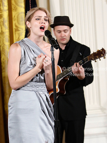 Singer Katharine McPhee performs during a reception in honor of International Women's Day hosted by U.S. President Barack Obama and first lady Michelle Obama at the East Room of the White House, Monday, March 8, 2010 in Washington, DC. The reception honored women from around the world and their achievements.  .Credit: Alex Wong - Pool via CNP