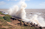 High energy waves eroding sea-wall, Bawdsey, Suffolk, England