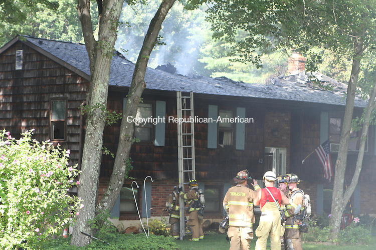 THOMASTON, CT, 07 August 2014-080714LW02 -  Firefighters put out hot spots at a fire at 42 View Drive in Thomaston Thursday afternoon.  Laraine Weschler Republican-American