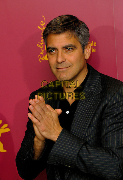 "GEORGE CLOONEY.Photocall for ""Syriana"" at the 56th Berlin (Berlinale) Film Festival, Berlin, Germany..February 10th, 2006.Ref: KRA.half length hands together praying.www.capitalpictures.com.sales@capitalpictures.com.©Capital Pictures"