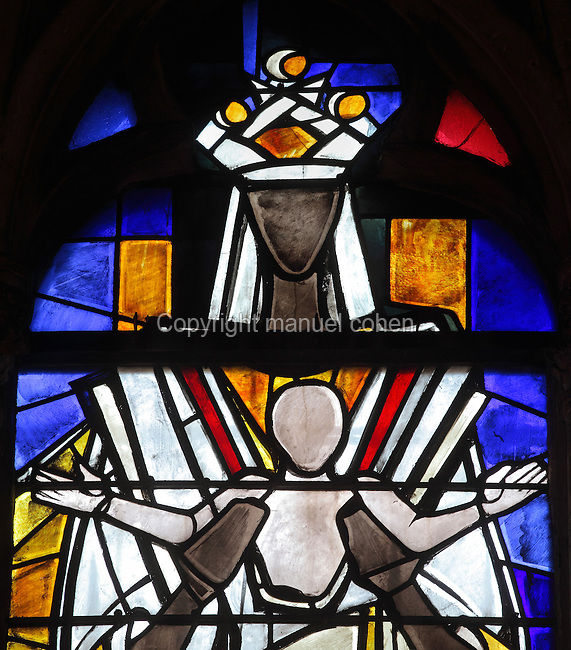 Stained glass window of a black Virgin presenting Christ the Redeemer, 1975, central lancet window in the North transept of the Basilica of Liesse Notre Dame, built 1134 in Flamboyant Gothic style by the Chevaliers d'Eppes, then rebuilt in 1384 and enlarged in 1480 and again in the 19th century, Liesse-Notre-Dame, Laon, Picardy, France. Pilgrims flock here to worship the Black Virgin, based on Ismeria, the Soudanese daughter of the sultan of Cairo El-Afdhal, who saved the lives of French knights during the Crusades, converted to christianity and married Robert d'Eppes, son of Guillaume II of France. Picture by Manuel Cohen