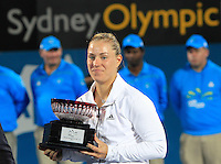 Angelique Kerber of Germany poses with the second place trophy after the final match at the Sydney International tennis tournament, Jan. 10, 2014.  Daniel Munoz/Viewpress IMAGE RESTRICTED TO EDITORIAL USE ONLY
