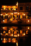Asia, Vietnam, Hoi An. Hoi An old quarter. View across the Thu Bon river onto the beautiful Bach Dang river promenade with it's romantic Hoa Anh Dao (Saigon Times Club) restaurant. The historic buildings, attractive tube houses, and decorated community halls have 1999 earned Hoi An's old quarter the status of a UNESCO World Heritage Site. To protect the old quarter's character stringent conversation laws prohibit alterations to buildings, as well as the presence of cars on the roads.