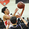 Joshua Serrano #1 of Amityville drives to the hoop for two points during a Suffolk County varsity boys basketball game against Sayville at Amityville High School on Thursday, Jan. 5, 2017. Amityville won by a score of 81-73.