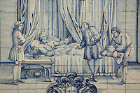 The old man and his children, from the fables of La Fontaine, traditional blue and white azulejos tile scene, 18th century, in the cloister of the Monastery of Sao Vicente de Fora, an Augustinian order monastery and church built in the 17th century in Mannerist style, Lisbon, Portugal. The monastery also contains the royal pantheon of the Braganza monarchs of Portugal. Picture by Manuel Cohen