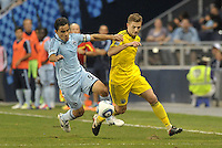Omar Bravo Sporting KC fights for the ball with Robbie Rogers Columbus Crew... Sporting Kansas City defeated Columbus Crew 2-1 at LIVESTRONG Sporting Park, Kansas City, Kansas.