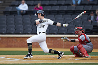 Chris Lanzilli (24) of the Wake Forest Demon Deacons follows through on his swing against the Sacred Heart Pioneers at David F. Couch Ballpark on February 15, 2019 in  Winston-Salem, North Carolina.  The Demon Deacons defeated the Pioneers 14-1. (Brian Westerholt/Four Seam Images)