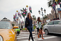 Stefanie A (left) and Diana Basfam (right), students of the International University of Monaco, walk through Casino Square, Monte Carlo, Monaco, 19 April 2013