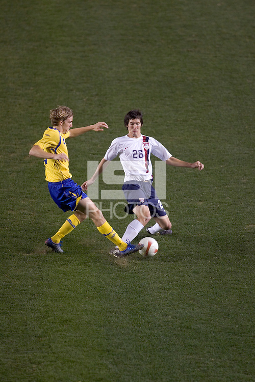 USA midfielder (26) Sacha Kljestan battles Sweden defender (3) Mattias Bjarsmyr during the second half. The United States defeated Sweden 2-0 during an international friendly at the Home Depot Center in Carson, California on Saturday, January 19, 2008.