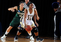 Florida International University guard Kamika Idom (14) plays against Stetson University in the first round of the NIT.  FIU won the game 75-47 on March 15, 2012 at Miami, Florida. .