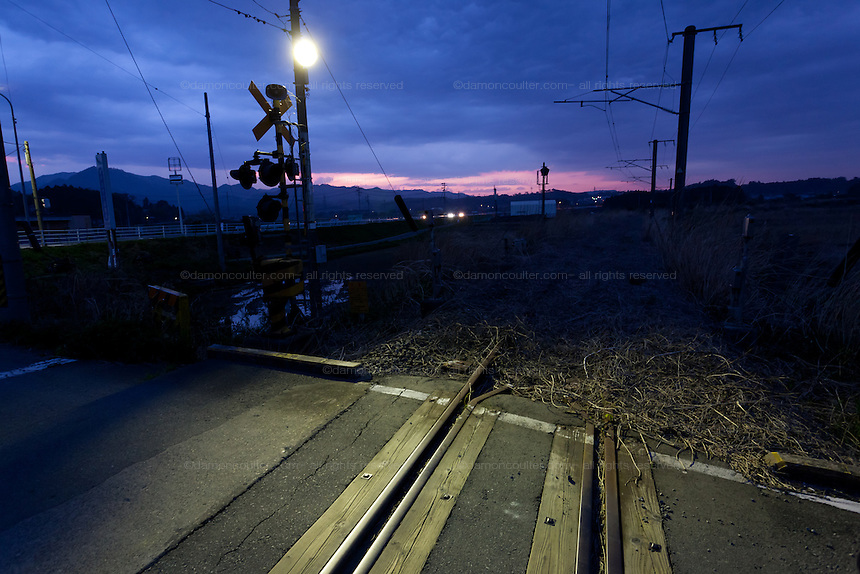 A level crossing on railway tracks near Nahara inside the 20 Kilometre exclusion zone around Fukushima Daichi nuclear power station. Fukushima, japan. Tuesday April 30th 2013