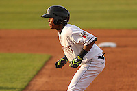 Wisconsin Timber Rattlers second baseman Gregory Munoz (7) takes a lead off first base during a game against the Cedar Rapids Kernels on May 4th, 2015 at Fox Cities Stadium in Appleton, Wisconsin.  Cedar Rapids defeated Wisconsin 9-3.  (Brad Krause/Four Seam Images)