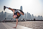 B-Boy Lilou in action on Hong Kong's Victoria Harbour waterfront.