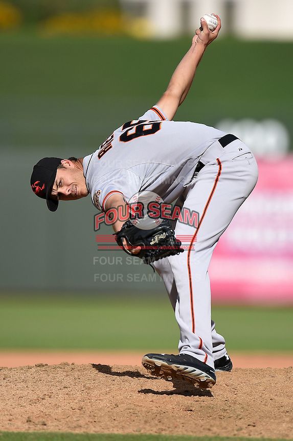 Scottsdale Scorpions pitcher Tyler Rogers (65) during an Arizona Fall League game against the Peoria Javelinas on October 18, 2014 at Surprise Stadium in Surprise, Arizona.  Peoria defeated Scottsdale 4-3.  (Mike Janes/Four Seam Images)