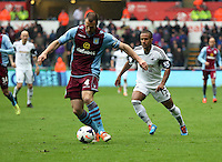 Sunday, 26 April 2014<br /> Pictured: Wayne Routledge (R) of Swansea against Ron Vlaar of Aston Villa (L).<br /> Re: Barclay's Premier League, Swansea City FC v Aston Villa at the Liberty Stadium, south Wales.