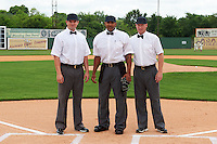 Umpires Adam Beck, J.J. January and James Rackley before the 20th Annual Rickwood Classic Game between the Jacksonville Suns and Birmingham Barons on May 27, 2015 at Rickwood Field in Birmingham, Alabama.  Jacksonville defeated Birmingham by the score of 8-2 at the countries oldest ballpark, Rickwood opened in 1910 and has been most notably the home of the Birmingham Barons of the Southern League and Birmingham Black Barons of the Negro League.  (Mike Janes/Four Seam Images)