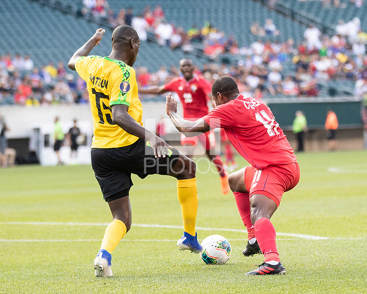PHILADELPHIA, PA - JUNE 30: Armando Cooper #11 and Je-Vaughn Watson #15 contest the ball during a game between Panama and Jamaica at Lincoln Financial Field on June 30, 2019 in Philadelphia, Pennsylvania.