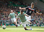 Kyle Benedictus brings down Celtic's Lassad Noulol for a penalty
