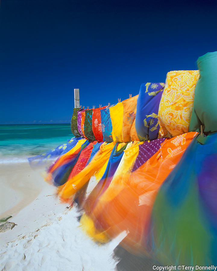 Antigua, West Indies   <br /> Breeze blown sarongs on a beach vendor's rack -  Long Beach, Caribbean Islands