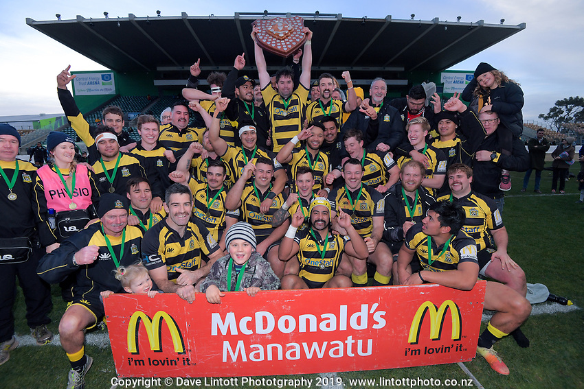 Feilding Yellows celebrate winning the 2019 Manawatu premier club rugby Hankins Shield final match between Varsity and Feilding Yellows at CET Arena in Palmerston North, New Zealand on Saturday, 13 July 2019. Photo: Dave Lintott / lintottphoto.co.nz