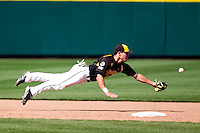 Tyler Grimes (12) of the Wichita State Shockers dives for a ground ball during a game against the /m/ on April 9, 2011 at Hammons Field in Springfield, Missouri.  Photo By David Welker/Four Seam Images