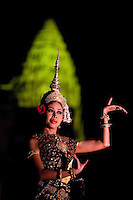 January 15th, 2009_SIEM REAP, CAMBODIA_ Apsara dancers take part in a grand performance at the base of Cambodia's number one tourist attraction, the Anchor Wat Temple.  Anchor Wat is a vast complex of temples and other significant structures and is a UNESCO World Heritage site.  Photographer: Daniel J. Groshong/Tayo Photo Group