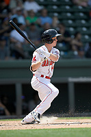 Shortstop Grant Williams (4) of the Greenville Drive bats in a game against the Hickory Crawdads on Tuesday, April 30, 2019, at Fluor Field at the West End in Greenville, South Carolina. Hickory won, 5-4. (Tom Priddy/Four Seam Images)