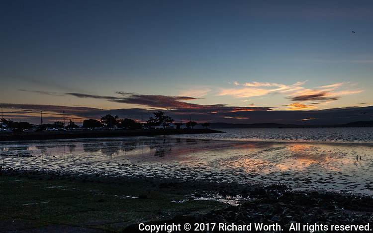 At low tide, sunset reflects in the silvery flats along San Francisco Bay's eastern shoreline.