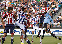 Chivas forward Atiba Harris (24) and rookie goalkeeper Lance Parker (21) clear a ball out of the box during a SuperLiga game. Pachuca CF defeated the Chivas USA 2-1 during the 1st round of the 2008 SuperLiga at Home Depot Center stadium, in Carson, California on Sunday, July 13, 2008.