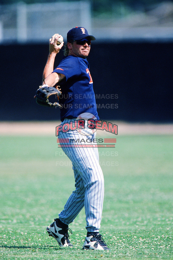 Jeremy Giambi of the Cal State Fullerton Titans throws before a 1996 NCAA baseball season game against the Pepperdine Waves at Eddy D. Field Stadium in Malibu, California. (Larry Goren/Four Seam Images)