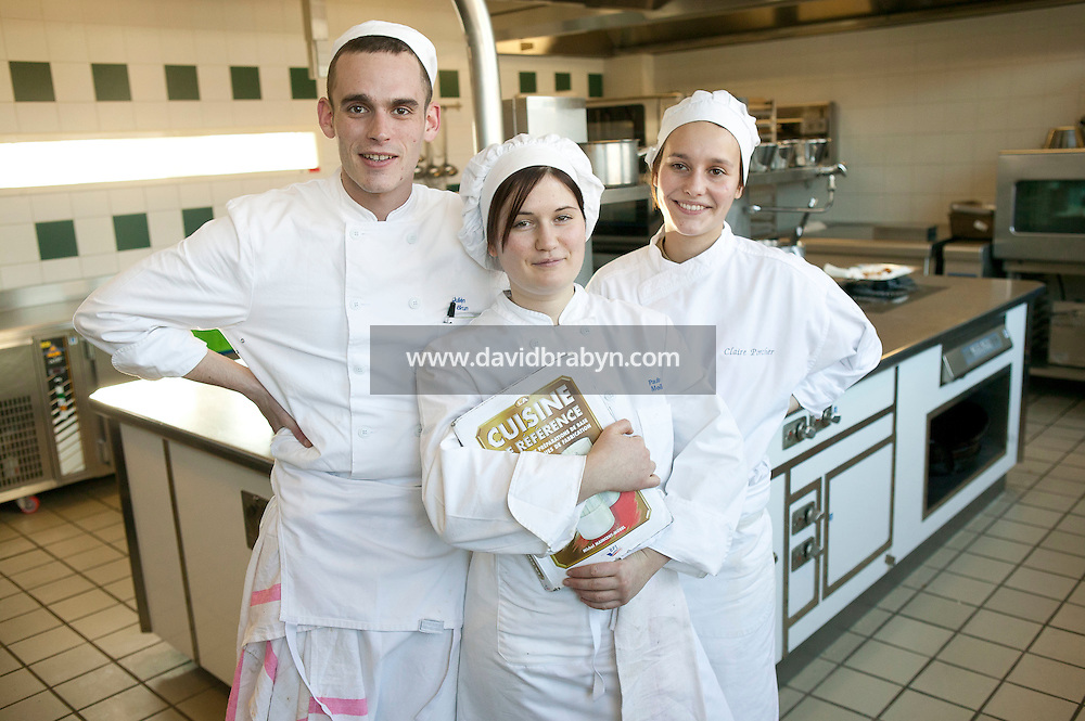 Students (LtoR) Julien Brun, Pauline Meillier and Claire Porcher pose for the photographer in a kitchen at the Ecole Superieure de Cuisine Francaise Gregoire Ferrandi cooking school in Paris, France, 18 December 2007.