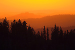Sunset over the receding ridges and foothills of the Sierra Nevada from Peddler Hill, Amador County, Calif.