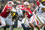 Wisconsin Badgers linebackers Ryan Connelly (43) and T.J. Edwards (53) tackle Michigan Wolverines running back Chris Evans (12) during an NCAA College Big Ten Conference football game Saturday, November 18, 2017, in Madison, Wis. The Badgers won 24-10. (Photo by David Stluka)