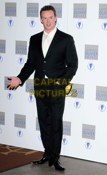 RUSSELL WATSON.The Laurence Olivier Awards 2010, Grosvenor House Hotel, London, England. .21st March 2010.full length opera singer black suit hand in pocket.CAP/CAN.©Can Nguyen/Capital Pictures.