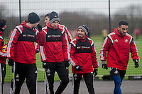 SWANSEA, WALES - JANUARY 28: Gylfi Sigurosson Jonjo Shelvey, Leon Britton of Swansea City and Neil Taylor of Swansea City  make their way to the playing field prior to training  on January 28, 2015 in Swansea, Wales.