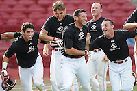 Freshman infielder George Iskenderian (28) of the South Carolina Gamecocks, center, celebrates his two-out two-run walk-off homer in the bottom of the seventh inning to lift the Black team to a 3-2 win over the Garnet squad in Game 1 of the Garnet & Black World Series on Oct. 25, 2012, at Carolina Stadium in Columbia, South Carolina. These final weekend intrasquad games signal the end of fall practice. Game 2 is set for 6 p.m. Friday. (Tom Priddy/Four Seam Images)