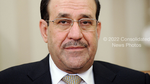 Prime Minister Nouri Al-Maliki of Iraq looks on during a meeting with United States President Barack Obama in the Oval Office at the White House, Friday, November 1, 2013 in Washington, DC. <br /> Credit: Olivier Douliery / Pool via CNP