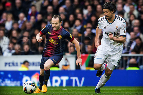 02.03.203 Madrid, Spain. Midfielder  Iniesta of FC Barcelona  (L) is challenged by Midfielder Sami khedira of Real Madrid during the Spanish La Liga game between Real Madrid and Barcelona from the Santiago Bernabeu.