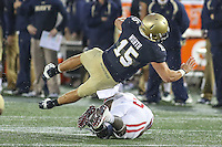 Annapolis, MD - October 8, 2016: Navy Midshipmen quarterback Will Worth (15) dives over a Houston Cougars defender during game between Houston and Navy at  Navy-Marine Corps Memorial Stadium in Annapolis, MD.   (Photo by Elliott Brown/Media Images International)