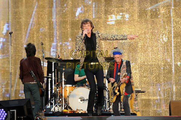 Ronnie Wood, Mick Jagger and Keith Richards of The Rolling Stones <br /> performing at Barclaycard British Summertime, Hyde Park, London, England, UK, <br /> 13th July 2013.<br /> music concert gig festival live on stage full length playing guitar band group drummer singing microphone gold black blazer patterned jacket <br /> CAP/MAR<br /> &copy; Martin Harris/Capital Pictures