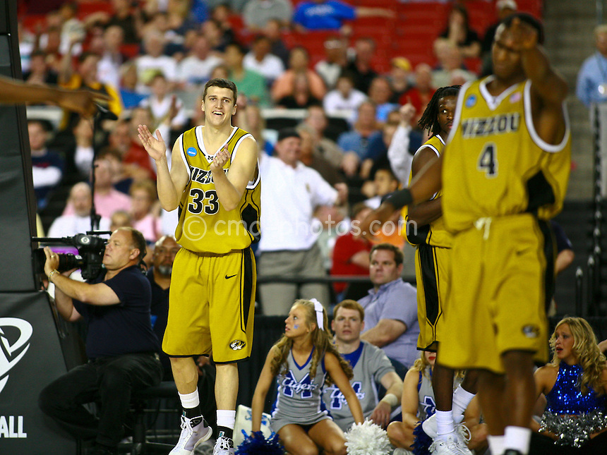 Mar 26, 2009; Tucson, AZ, USA; Missouri Tigers guard Matt Lawrence (33) and guard J.T. Tiller (4) react to forcing a turnover late in the second half of a game against the Memphis Tigers in the semifinals of the west region of the 2009 NCAA basketball tournament at University of Phoenix Stadium.    Missouri defeated Memphis 102-91.