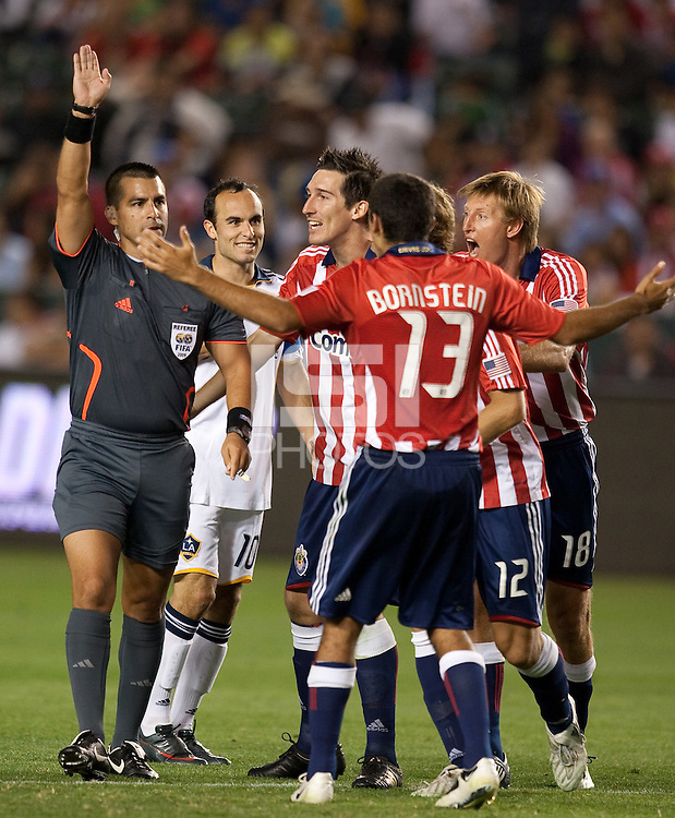Chivas USA players question the call of the referee. The LA Galaxy defeated Chivas USA 1-0 at Home Depot Center stadium in Carson, California Saturday evening July 11, 2009.