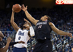Nevada forward  Tre'Shawn Thurman (0) grabs a rebound over San Diego State forward Matt Mitchell (11) in the first half of an NCAA college basketball game in Reno, Nev., Saturday, Mar. 9, 2019. (AP Photo/Tom R. Smedes)