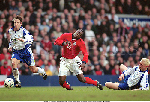 EMILE HESKEY is tripped by Sami Hyypia, ENGLAND 2 v Finland 1, World Cup Qualifier, Anfield 010324. Photo:Glyn Kirk/Action Plus...2001.Soccer.foul fouls fouling fouled.football.international.internationals.association