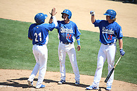 Zach McKinstry (24) and T.J. Peters (31) of the Rancho Cucamonga Quakes welcome teammate Yusniel Diaz (21) at home plate after scoring a run during a game against the Stockton Ports at LoanMart Field on May 28, 2017 in Rancho Cucamonga, California. Stockton defeated Rancho Cucamonga, 7-4. (Larry Goren/Four Seam Images)