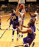 SIOUX FALLS, SD - MARCH 9:  Jordan Dykstra #42 from South Dakota State University takes the ball to the basket between Mike Miklusak #30, Adam Link #33 and Michael Ochereobia #52 from Western Illinois in the second half of their quarterfinal game at the 2014 Summit League Tournament Sunday evening in Sioux Falls, SD. (Photo by Dave Eggen/Inertia)